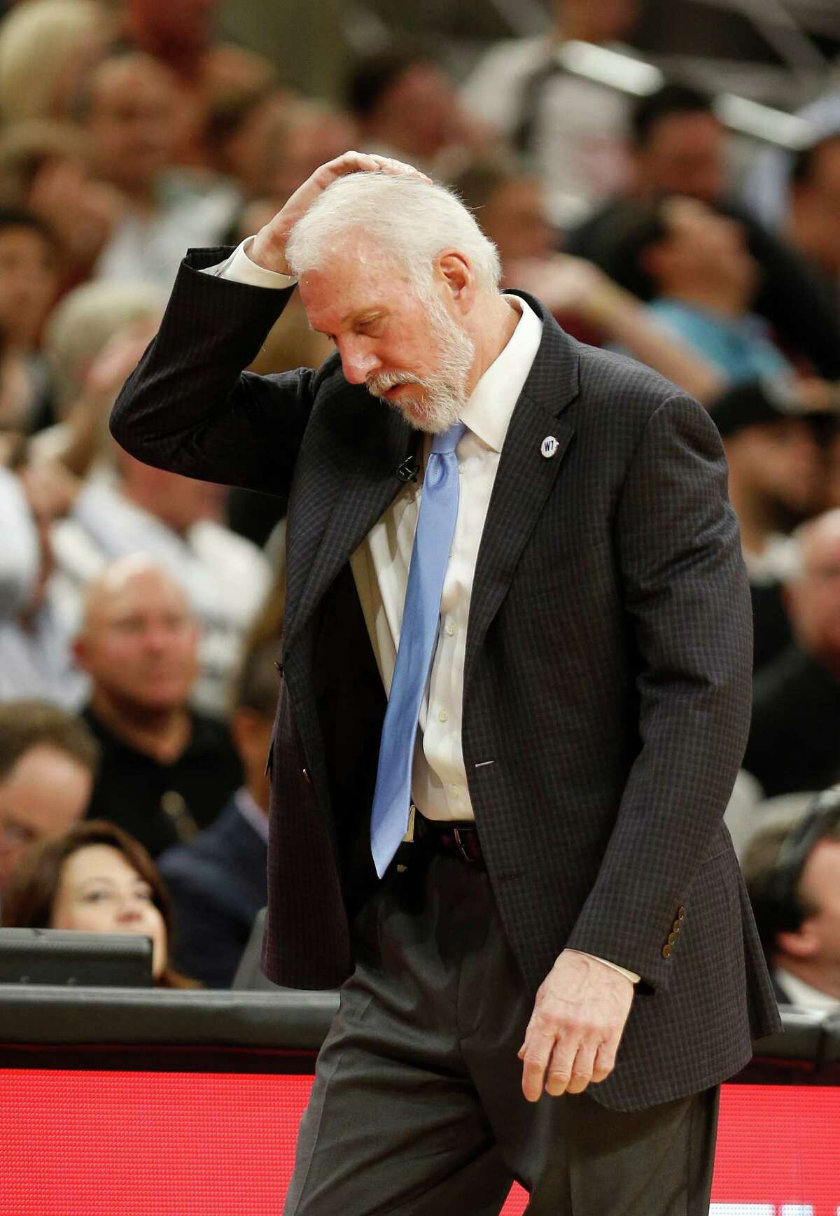 SAN ANTONIO,TX - MAY 10: Head coach Gregg Popovich of the San Antonio Spurs scratches his head in the closing seconds of the game against the Oklahoma City Thunder in game Five of the Western Conference Semifinals during the 2016 NBA Playoffs at AT&T Center on May 10, 2016 in San Antonio, Texas. NOTE TO USER: User expressly acknowledges and agrees that , by downloading and or using this photograph, User is consenting to the terms and conditions of the Getty Images License Agreement.