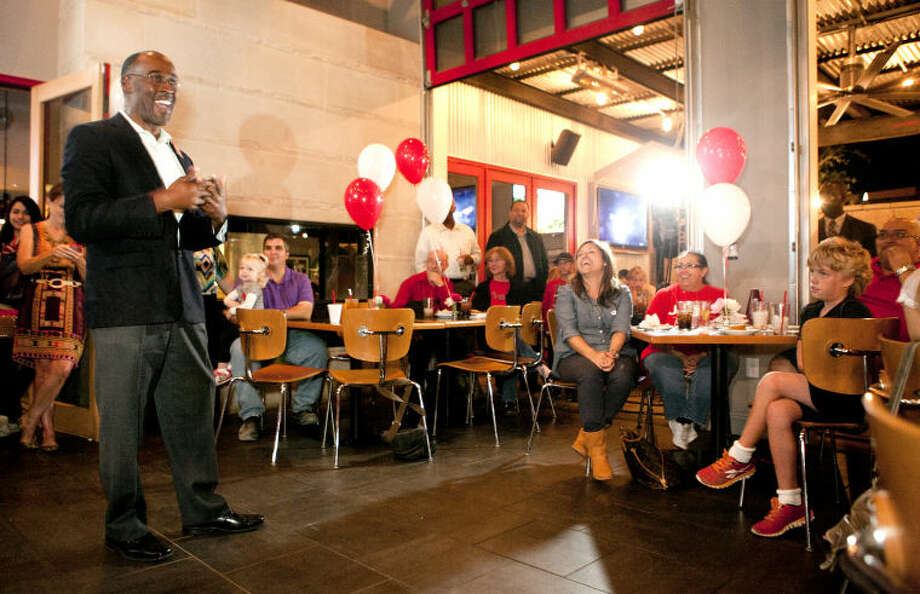 Mayoral candidate John James talks to supporters after viewing the early voting results during a John James mayoral campaign party Tuesday at Basin Burger House. James Durbin/Reporter-Telegram Photo: JAMES DURBIN