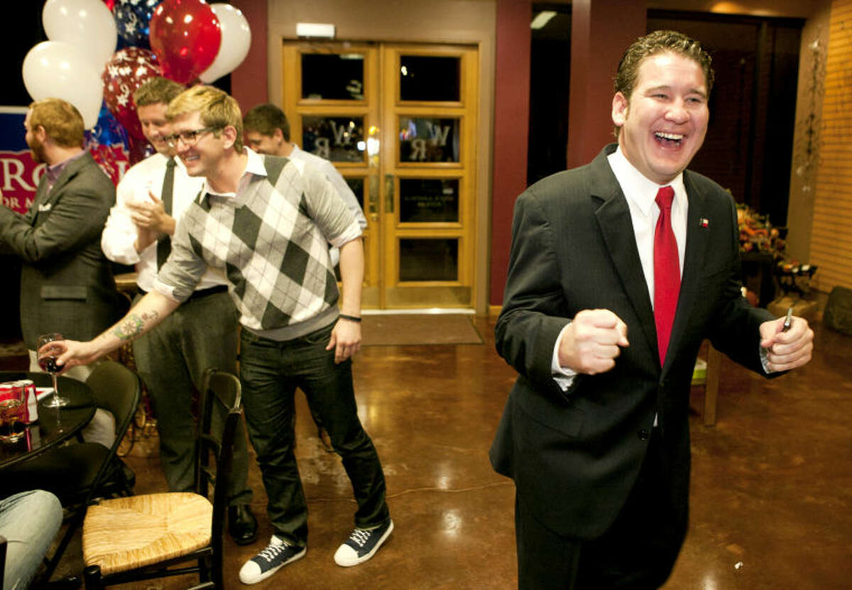 Councilman-elect J. Ross Lacy reacts after announcing his victory during a party Tuesday at The Wine Rack. James Durbin/Reporter-Telegram