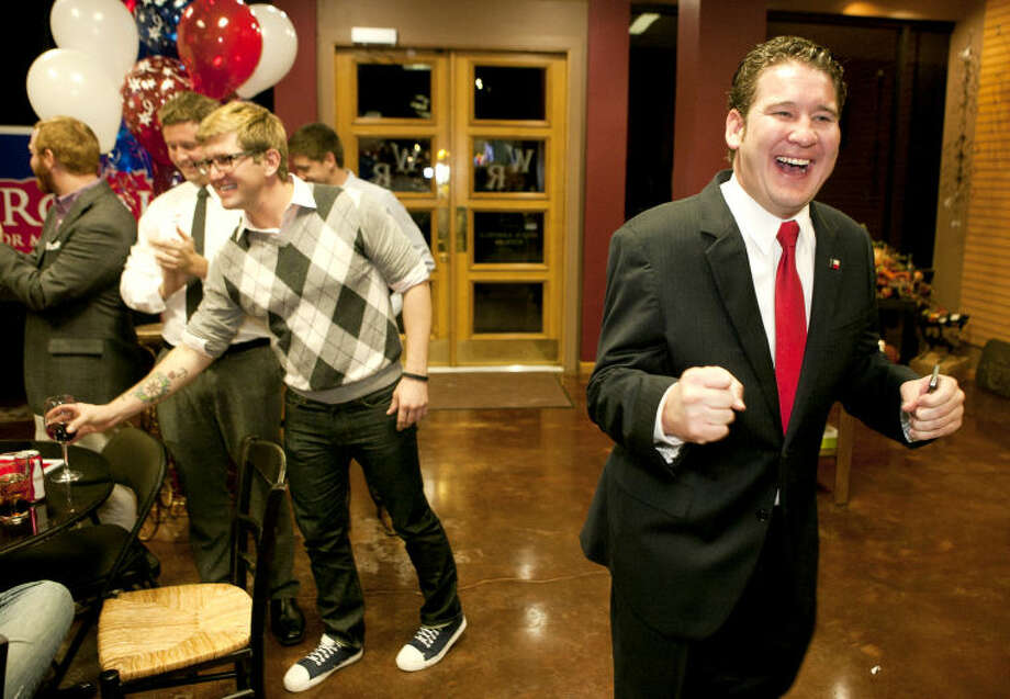 Councilman-elect J. Ross Lacy reacts after announcing his victory during a party Tuesday at The Wine Rack. James Durbin/Reporter-Telegram Photo: JAMES DURBIN