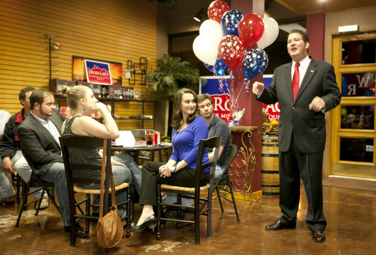 Councilman-elect J. Ross Lacy speaks to supporters during his victory party Tuesday at The Wine Rack. James Durbin/Reporter-Telegram