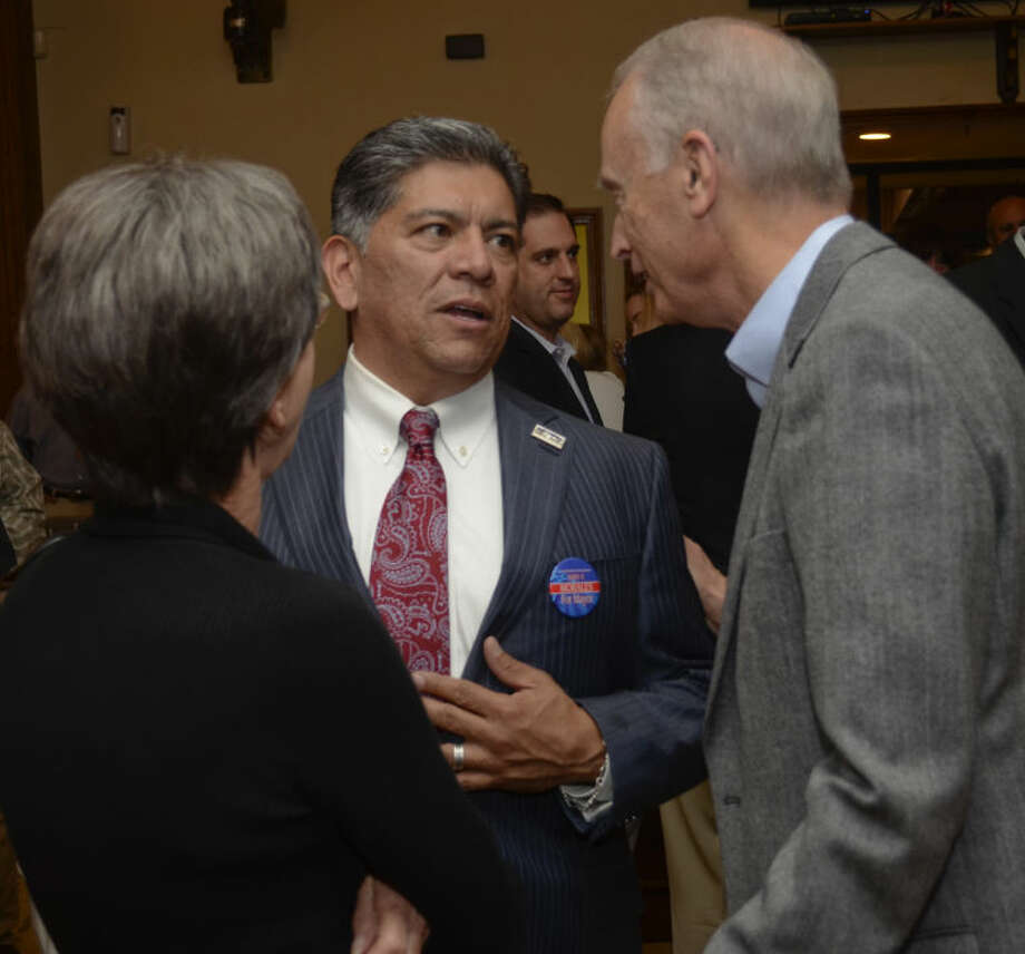 Carroll and Georgia Thomas congratulate Jerry Morales Tuesday evening as election results are announced. Tim Fischer\Reporter-Telegram Photo: Tim Fischer