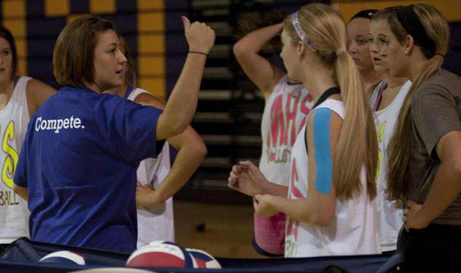 Midland High volleyball coach Amanda Lopez talks with her players Aug. 5. Tim Fischer\Reporter-Telegram Photo: Tim Fischer
