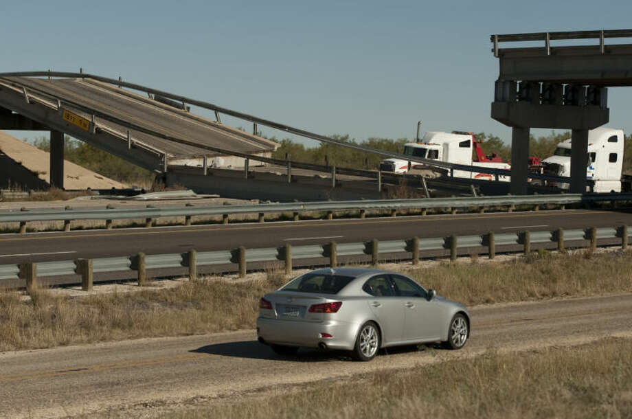 I-20 West just outside of Big Spring is closed following a accident Tuesday evening after a semi-trailer hit the overpass support and the overpass collapsed onto westbound lanes of I-20 near mile marker 170. Tim Fischer\Reporter-Telegram Photo: Tim Fischer