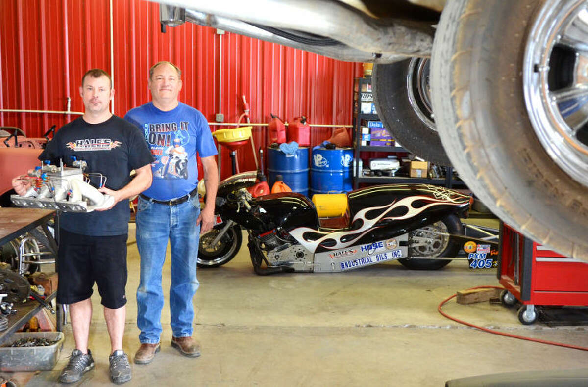 Blaine Hall and his father Clayton Hale pose for a portrait at Hale's House of Speed on Tuesday. James Durbin/Reporter-Telegram