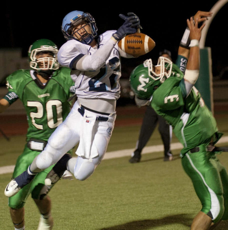 Greenwood's Braydin Moreland can't hold on to the pass as Monahans' Bryan Venegas, 3, and Jnior Morales, 20, defend in the endzone Friday evening in Monahans. Tim Fischer\Reporter-Telegram Photo: Tim Fischer
