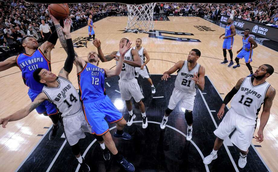Oklahoma City Thunder's Russell Westbrook and Steven Adams grab for a rebound over the Spurs' Danny Green as Kawhi Leonard, Tony Parker, Tim Duncan, and LaMarcus Aldridge look on during Game 5 in the Western Conference semifinals on May 10, 2016 at the AT&T Center. The Thunder won 95-91. Photo: Edward A. Ornelas /San Antonio Express-News / © 2016 San Antonio Express-News