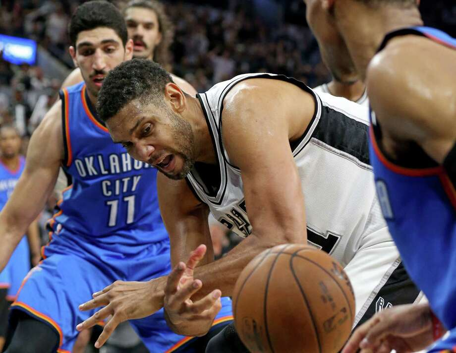 Spurs' Tim Duncan grabs for a loose ball between Oklahoma City Thunder's Enes Kanter (left) and Oklahoma City Thunder's Russell Westbrook during second half action of Game 5 in the Western Conference semifinals on May 10, 2016 at the AT&T Center. The Thunder won 95-91. Photo: Edward A. Ornelas /San Antonio Express-News / © 2016 San Antonio Express-News