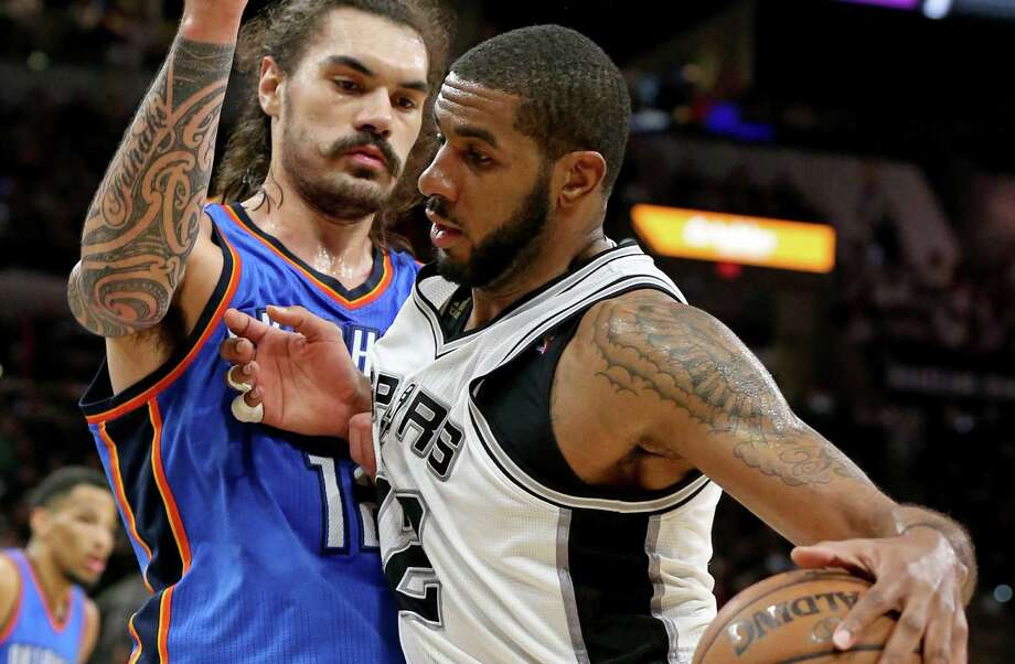 Spurs' LaMarcus Aldridge looks for room around Oklahoma City Thunder's Steven Adams during second half action of Game 5 in the Western Conference semifinals on May 10, 2016 at the AT&T Center. The Thunder won 95-91. Photo: Edward A. Ornelas /San Antonio Express-News / © 2016 San Antonio Express-News