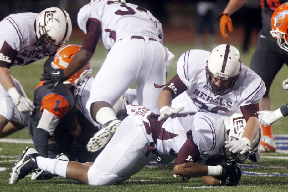 Patrick Dove/Standard-Times Midland Lee High School's Brives Turner falls on a loose ball for a fumble recovery Friday night during a District 2-5A game against San Angelo Central at San Angelo Stadium. shot/archvied 11.08.13 Photo: Patrick Dove