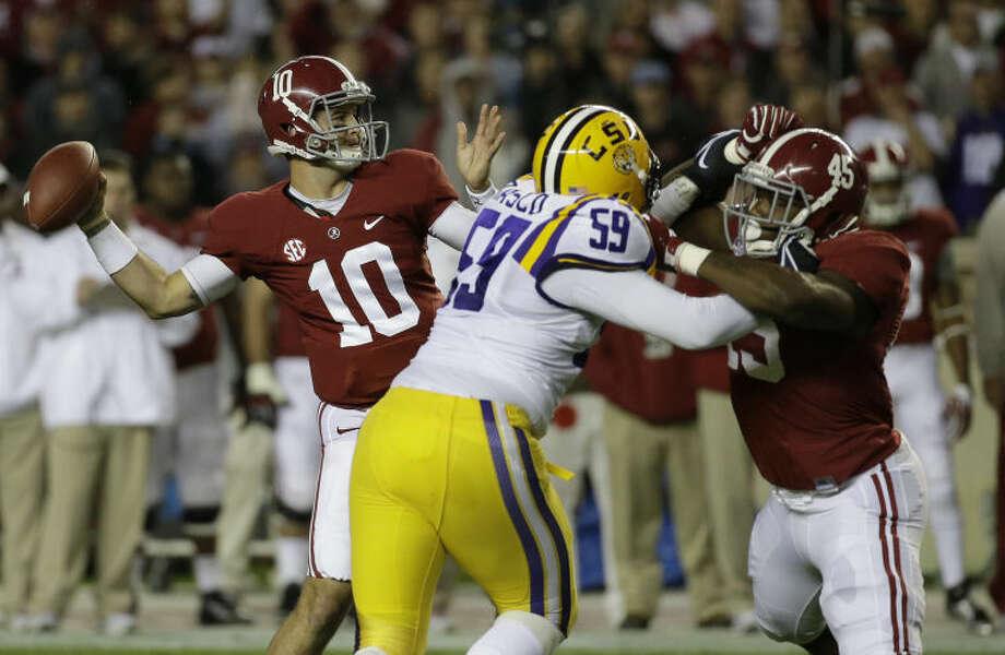Alabama quarterback AJ McCarron (10) works against LSU during the first half of an NCAA college football game, Saturday, Nov. 9, 2013, in Tuscaloosa, Ala. (AP Photo/Dave Martin) Photo: Dave Martin