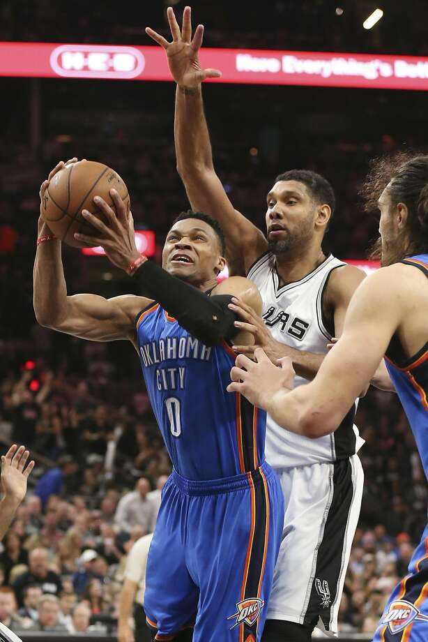 Russell Westbrook works in front of San Antonio's Tim Duncan in the second half of Oklahoma City's victory. Photo: JERRY LARA, San Antonio Express-News