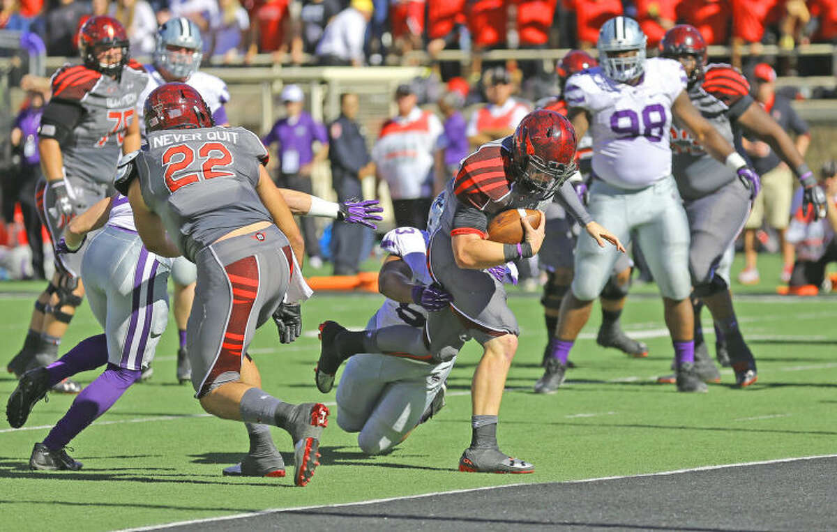 Texas Tech qurterback Baker Mayfield drags a defender as he crosses the goal line for a Red Raider score in Saturday's Big XII game against the Kansas State Wildcats.