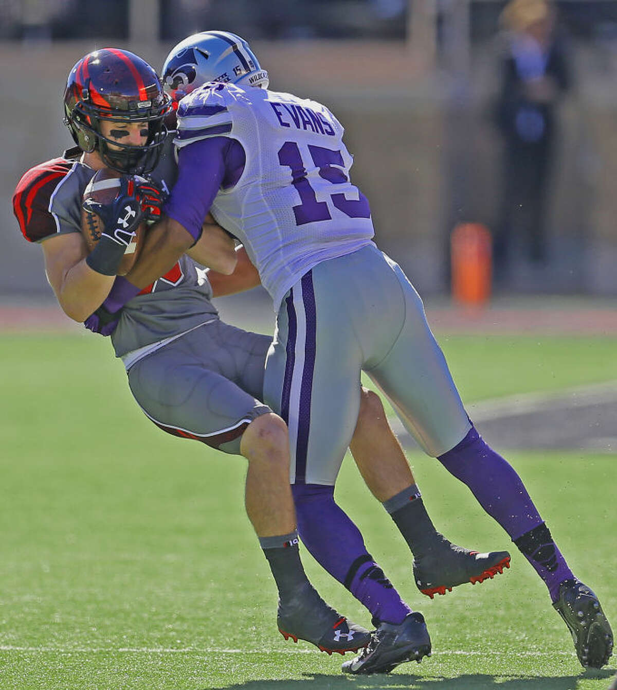 Texas Tech receiver Jordan Davis (85) is decleated by Kansas State defensive back Randall Evans (15) in Saturday Big XII action at Jones AT & T stadium in Lubbock.