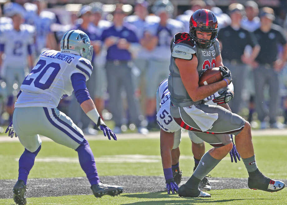 Texas Tech receiver Jace Amaro (22) turns upfield after catching a pass in Big XII action against Kansas State on Nov. 9 at Jones AT&T stadium. Photo: Wade H Clay