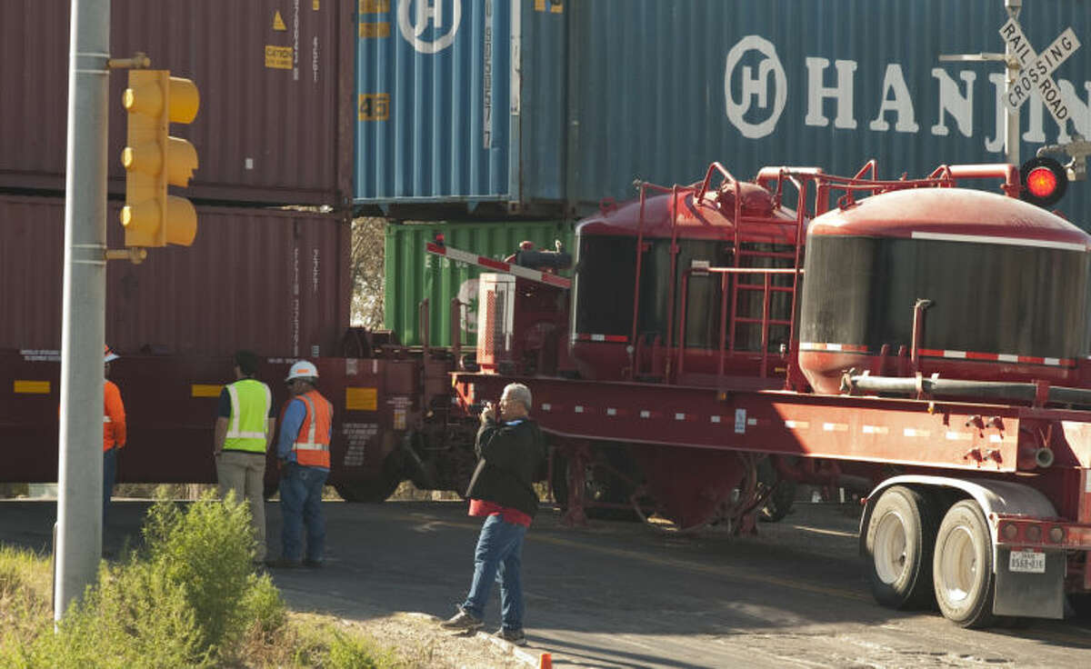 An 18 wheeler truck stalled on the train crossings at Fairgrounds Road Sunday morning and was struck by a train. The driver of the truck was able to get out before the cab was struck and burst into flames. Tim Fischer\Reporter-Telegram