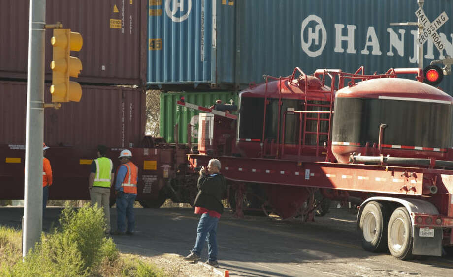 An 18 wheeler truck stalled on the train crossings at Fairgrounds Road Sunday morning and was struck by a train. The driver of the truck was able to get out before the cab was struck and burst into flames. Tim Fischer\Reporter-Telegram Photo: Tim Fischer