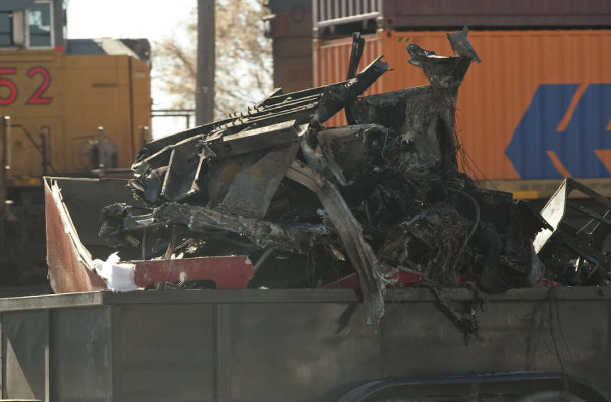 An 18 wheeler truck stalled on the train crossings at Fairgrounds Road Sunday morning and was struck by a train. The driver of the truck was able to get out before the cab was struck and burst into flames. This is part of what is left of the cab of the truck. Tim Fischer\Reporter-Telegram