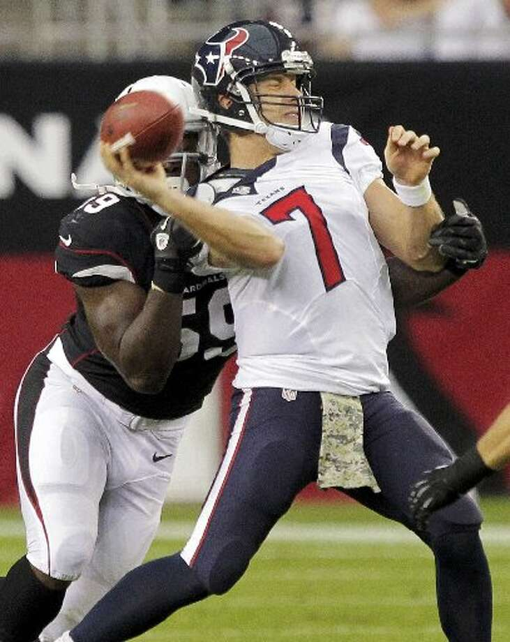 Houston quarterback Case Keenum (7) is hit by Arizona linebacker Marcus Benard during the first half of Sunday's game in Glendale, Ariz. Photo: Rick Scuteri/AP