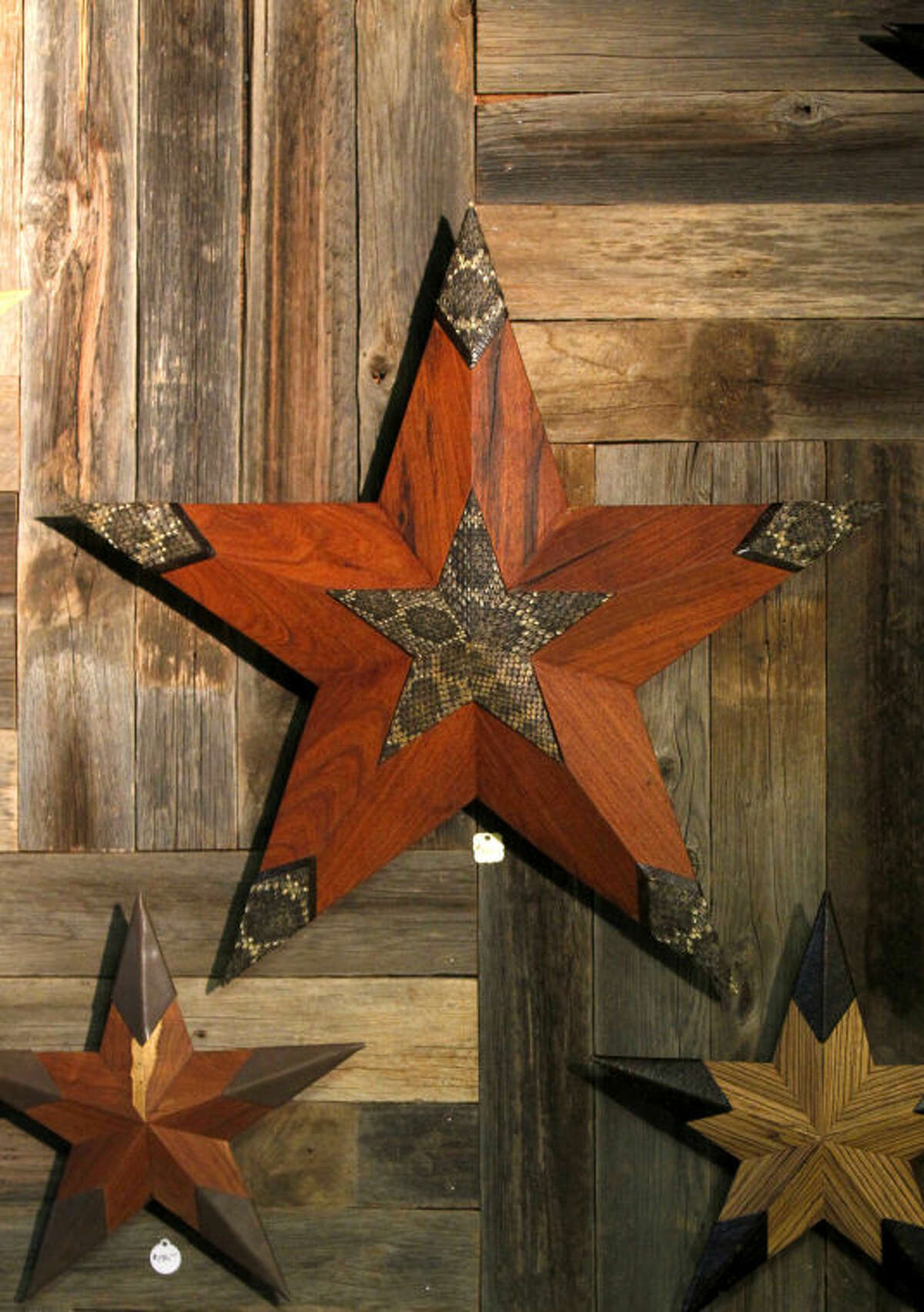 Stars handcrafted from wood and metal by local artist Steve Culver hang on display during an event featuring art by the artist as well as a Manuscript wine tasting on Saturday. James Durbin/Reporter-Telegram