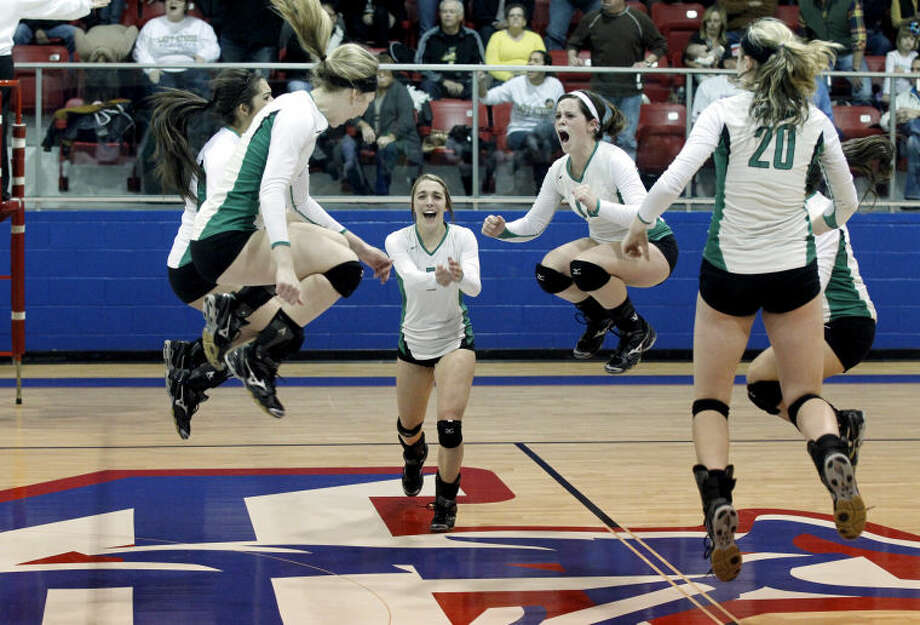 The Monahans volleyball team celebrates after beating Big Spring in Game 3 of a playoff match Tuesday at the Midland Christian McGraw Special Events Center. James Durbin/Reporter-Telegram Photo: JAMES DURBIN