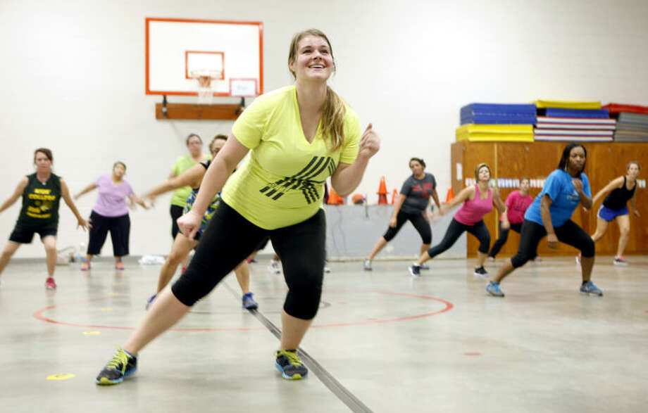 Lee Freshman biology teacher Heather Passons leads a Zumba class for Midland ISD employees Tuesday at Bonham Elementary. James Durbin/Reporter-Telegram Photo: JAMES DURBIN