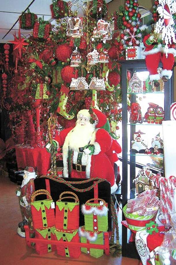 Santa and his elves want to help you get into the Christmas spirit at Flowerland, 413 Andrews Highway, so go see them today.