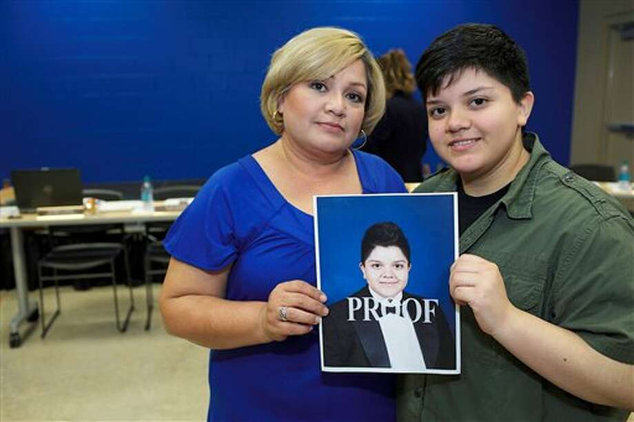 "This photo provided by the Southern Poverty Law Center shows Stella Loredo, left, and her son, Jeydon Loredo, a South Texas transgender teenager who grew up female but now identifies himself as a male. Jeydon and his mother say when he took a photograph wearing a tuxedo, his school district refused to allow the picture to appear in the yearbook because it violated ""community standards."" Loredo and attorneys with the Southern Poverty Law Center are threatening legal action against the La Feria Independent School District if it does not include the photo in the yearbook. (AP Photo/Southern Poverty Law Center, J Michael Short) Photo: J Michael Short / Southern Poverty Law Center"