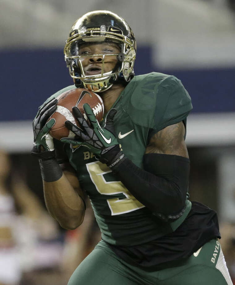 Baylor wide receiver Antwan Goodley (5) pulls in a touchdown pass against Texas Tech in Arlington on Saturday. (AP Photo/LM Otero) Photo: LM Otero