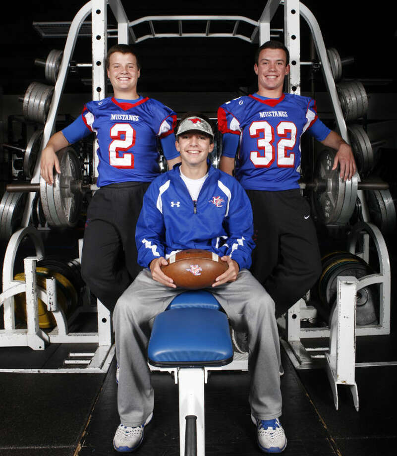 Midland Christian's football triplets from left, Davis, Luke and Justin Fender, pose for a portrait Thursday in the Midland Christian field house. James Durbin/Reporter-Telegram Photo: JAMES DURBIN