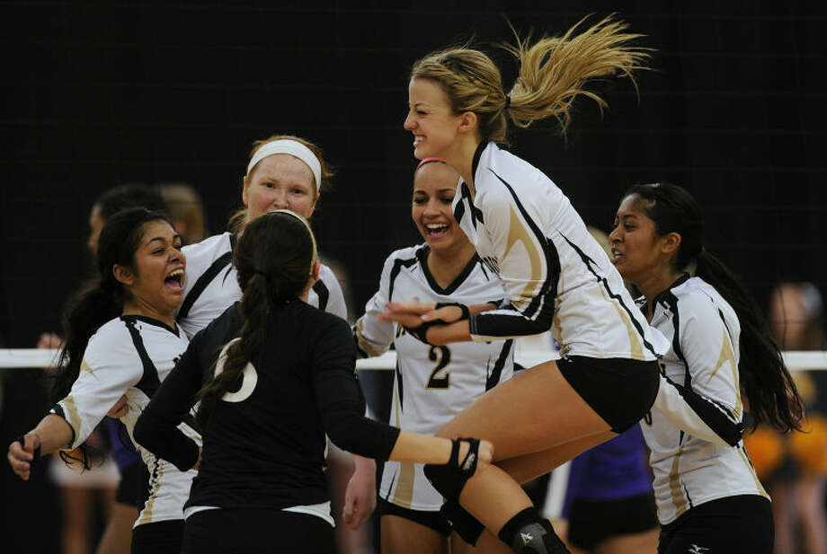 Big Spring players celebrate after winning the first game of the Lady Steers' win over Wylie in the Region I-3A championship volleyball match on Saturday at The Coliseum in Snyder. Thomas Metthe/Reporter-News Photo: Thomas Metthe