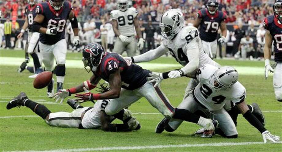 Houston Texans' Ben Tate fumbles near the goal line during the second half of an NFL football game against the Oakland Raiders Sunday, Nov. 17, 2013, in Houston.Tate recovered his own fumble The Raiders won 28-23. (AP Photo/Patric Schneider) Photo: Patric Schneider / FR170473 AP