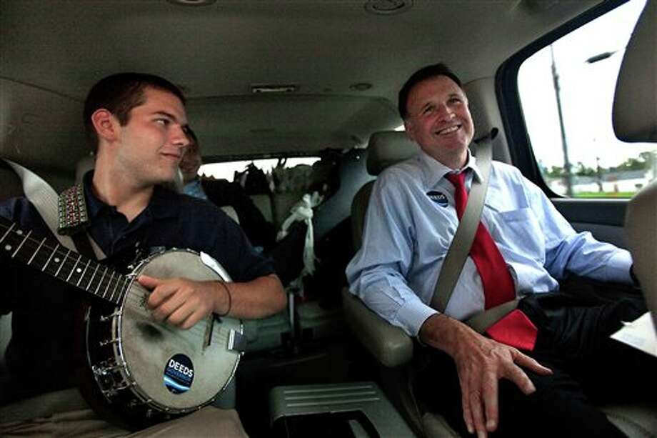 In a Sept. 25, 2009 photo, Democratic gubernatorial candidate Creigh Deeds spends time with his son Gus, left, on the road to Halifax, Va., between campaign events. Virginia State Police confirmed Tuesday, Nov. 19, 2013, that Creigh Deeds was stabbed multiple times and his son Gus, 24, was shot and killed at Deeds' Home in Bath County, Va., during a Tuesday morning assault. (AP Photo/The Virginian-Pilot, Hyunsoo Leo Kim) Photo: Hyunsoo Leo Kim / The Virginian-Pilot