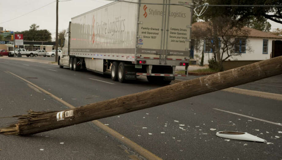 A one vehicle accident with a semi truck on Big Spring Street broke a telephone pole Tuesday morning that closed the road just after 9:15 a.m.Tim Fischer\Reporter-Telegram Photo: Tim Fischer