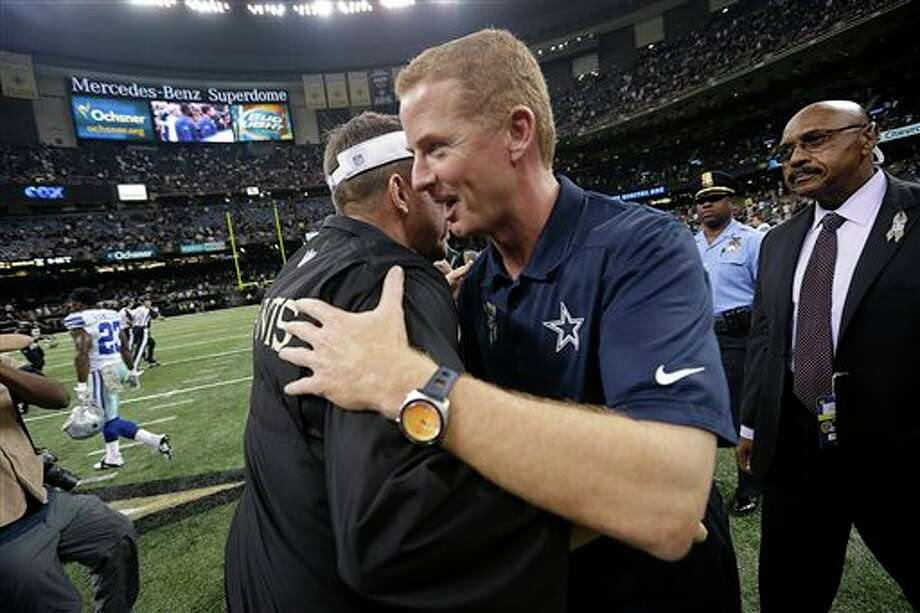 Dallas Cowboys head coach Jason Garrett, right, greets New Orleans Saints head coach Sean Payton after their NFL football game in New Orleans, Sunday, Nov. 10, 2013. The Saints won 49-17. (AP Photo/Dave Martin) Photo: Dave Martin / AP
