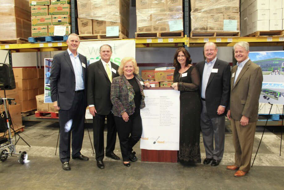 Since beginning its $12.7 million capital campaign in May, the West Texas Food Bank has raised more than $8.2 million in donations from foundations and individual donors for the construction of a new 20,000 square-foot facility in Midland and a 56,000 square-foot facility in Odessa. Scott Kidwell of Concho Resources, Don Barrett of The Bennett Family Charitable Fund, Capital Campaign Steering Committee Member Lorraine Perryman, West Texas Food Bank Executive Director Libby Campbell, Herb Cartwright of the Abell-Hanger Foundation and Grant Billingsley of The Scharbauer Foundation pose for a photo following a press conference Wednesday in Odessa. Courtesy photo