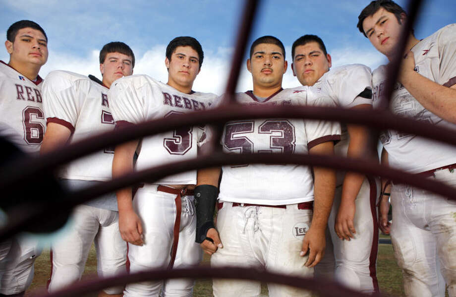 Lee offensive linemen from left, Manuel Perez, Dillon Tranum, Griffin Quintero, Anthony Vega, Jacob Molina and Diego Alvarado pose for a portrait Wednesday at Lee High. James Durbin/Reporter-Telegram Photo: JAMES DURBIN