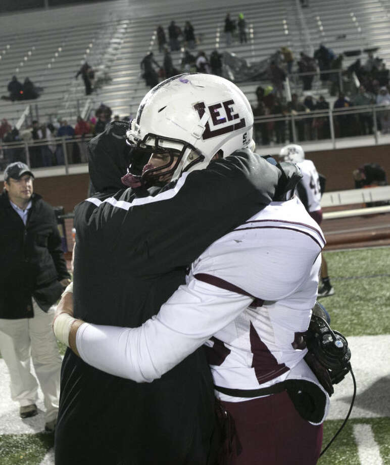 Lee coach Daryl Jones embraces Nathan Bailey after the Rebels lost to Southlake Carroll 51-7 on Friday night. Photo: Scott Pearson