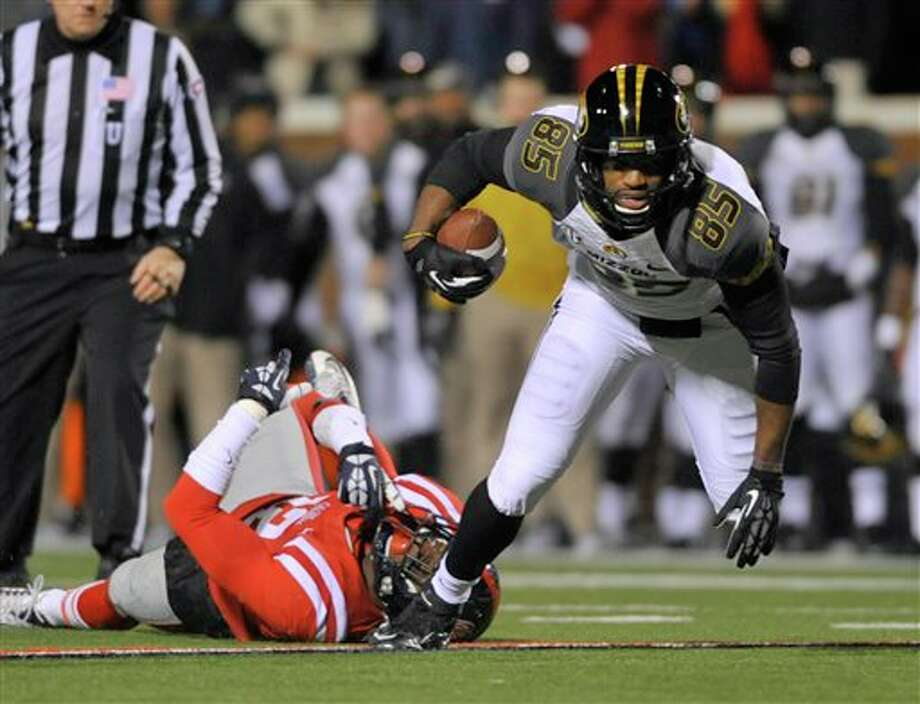 Missouri receiver Marcus Lucas (85) avoids being tackled by Mississippi defensive back Tony Conner (12) during the first quarter of an NCAA college football game on Saturday, Nov. 23, 2013, in Oxford, MS. #8 Missouri beat #24 Mississippi 24-10. (AP Photo/ The Daily Mississippian, Austin McAfee) Photo: Austin McAfee / The Daily Mississippian