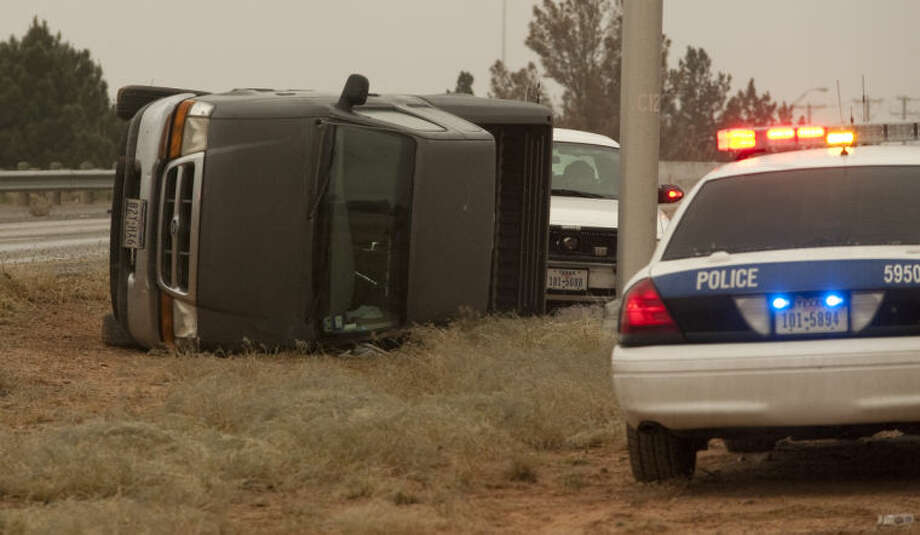 Midland police as well as area law enforcement responded to multiple accidents around the area, like this one vehicle rollover on Loop 250 on the Thomason overpass. Tim Fischer\Reporter-Telegram Photo: Tim Fischer