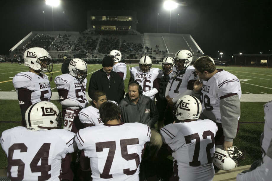 Midland Lee coach Mike Conley rallies his players during the 2nd half of their game against Southlake Carol at Chisholm Trail Stadium in Fort Worth, TX on Novermber 22, 2013. Photo by: Scott Pearson Photo: Scott Pearson