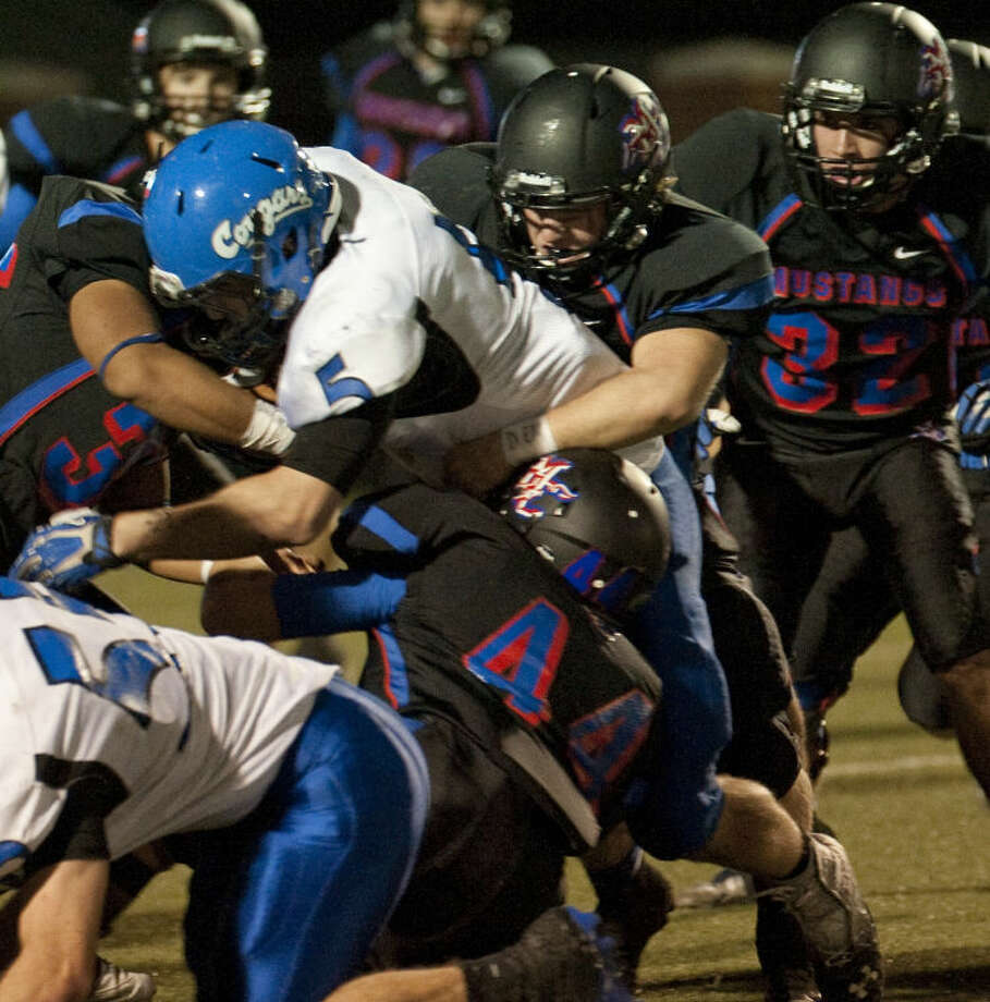 The Midland Christian defense combines to stop Tyler Grace's Zach Tatman for no gain Nov. 21 at Mustang Field. Tim Fischer\Reporter-Telegram Photo: Tim Fischer