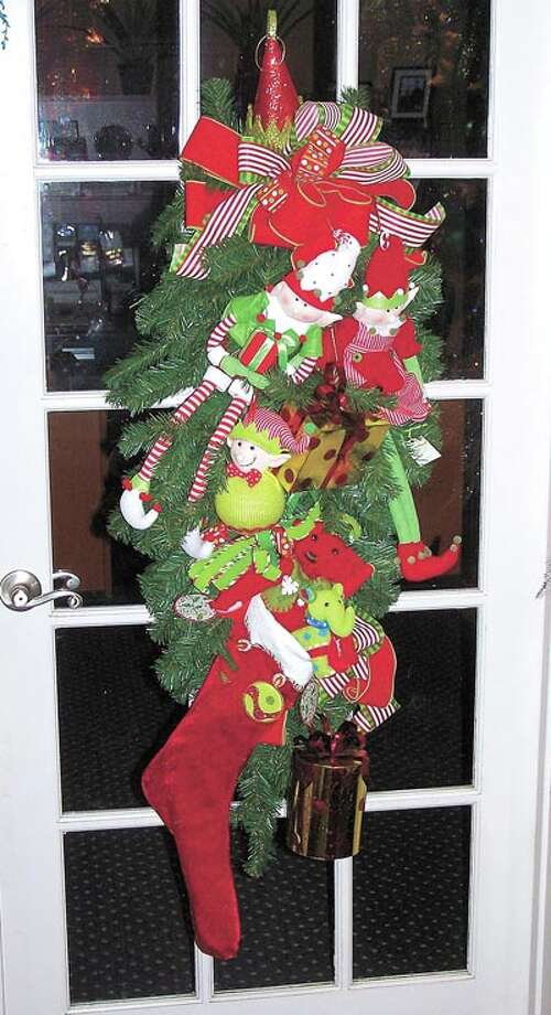 Want a quick start to your holiday decorating? Go by Flowerland and see their selection of premade wreaths. If you have your own ideas, ask them to make one specially for you. Flowerland is at 413 Andrews Highway.
