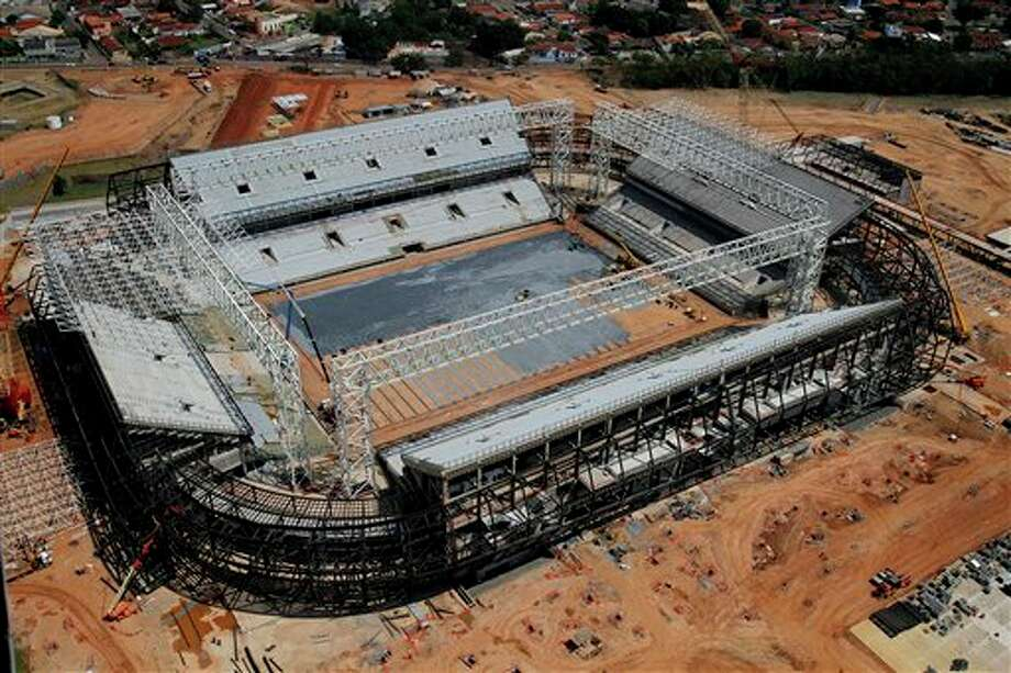 FILE - In this Sept. 2013 file photo released by Portal da Copa shows an aerial view of the Arena Pantanal stadium in Cuiaba, Mato Grosso state, Brazil. Brazil risks missing the December deadline for the delivery of its World Cup stadiums because of a court battle over the purchase of seats for this venue. (AP Photo/Edson Rodrigues, Portal da Copa, File) Photo: Edson Rodrigues / Portal da Copa