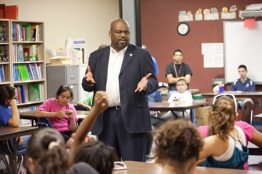 (File Photo) Midland County Justice of the Peace Bill Johnson Jr. talks about his role as a judge and about making good decisions Wednesday during the MPD Kids Police Academy at Casa de Amigos. Photo: Cindeka Nealy