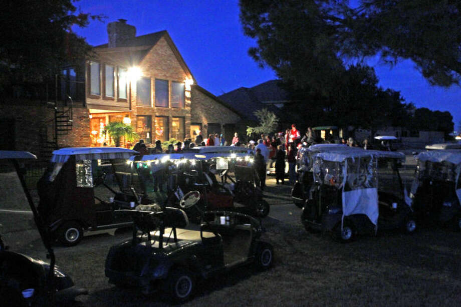 Carolers sing during Green Tree Country Club's annual golf cart caroling with Santa event Tuesday at Green Tree Country Club. James Durbin/Reporter-Telegram Photo: JAMES DURBIN
