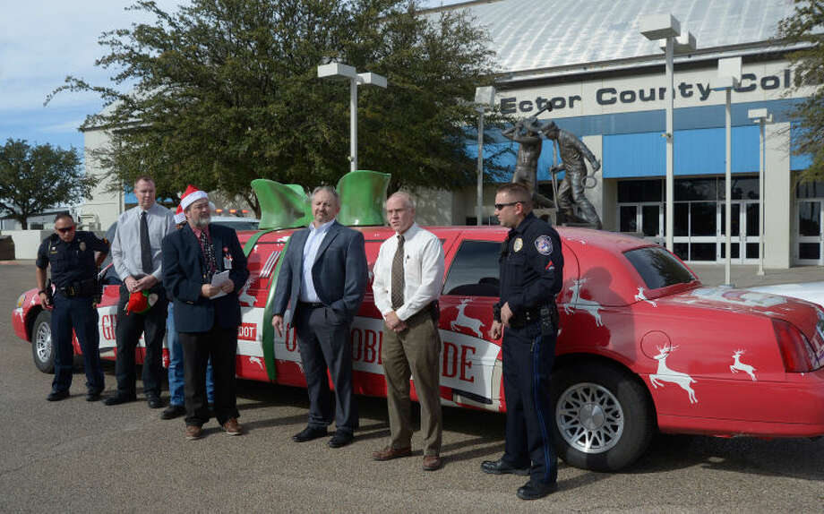 Representatives from the Texas Department of Transportation, Odessa Police Department and Midland Police Department talk about the importance of driving sober during the holidays as part of the Sober Sleigh campaign that made a stop Wednesday in the Midland and Odessa area. Photo: Mark Sterkel|Odessa American