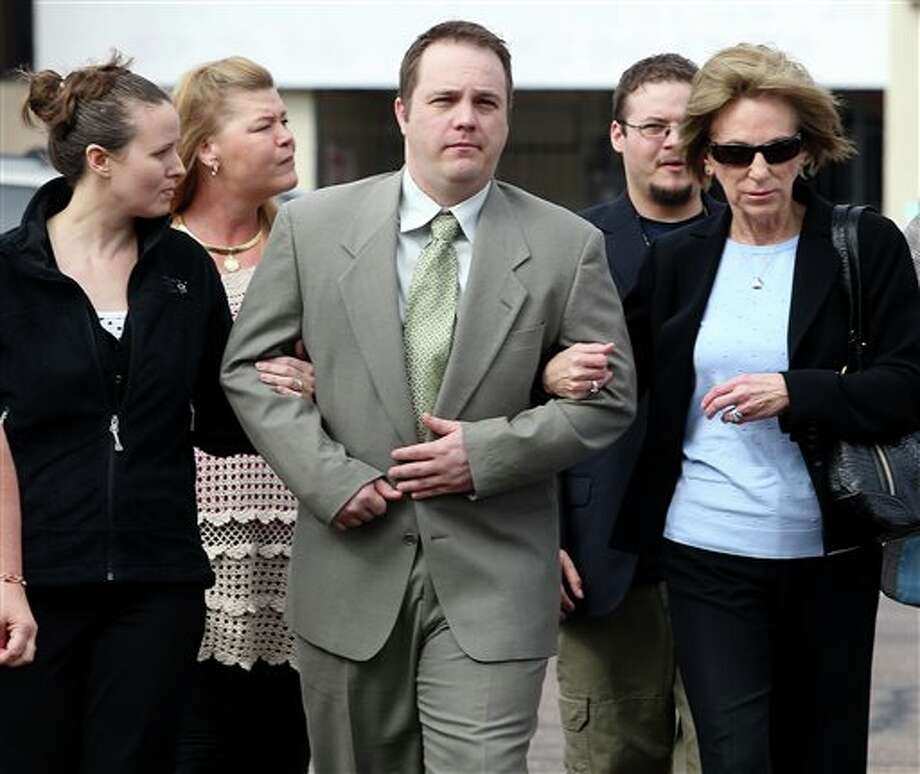 Former West, Texas, paramedic Bryce Reed, center, walks to Federal Court with relatives for his sentencing hearing Wednesday, Dec. 4, 2013, in Waco Texas. Reeds was sentenced to 21 months in prison after pleading guilty in a pipe bomb case that isn't linked to the West Fertilizer Co. explosion that killed 15 people last April in West, Texas. (AP Photo/Waco Tribune Herald, Jerry Larson) Photo: Jerry Larson / Waco Tribune Herald