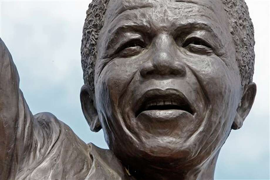 FILE - This Feb. 10, 2010 file photo shows a close up view of the statue of former South African President Nelson Mandela outside the Groot Drakenstein prison near the town of Franschhoek, South Africa, where Mandela was released on Feb. 11, 1990. On Thursday, Dec. 5, 2013, Mandela died at the age of 95. (AP Photo/Schalk van Zuydam, File) Photo: Schalk Van Zuydam / AP