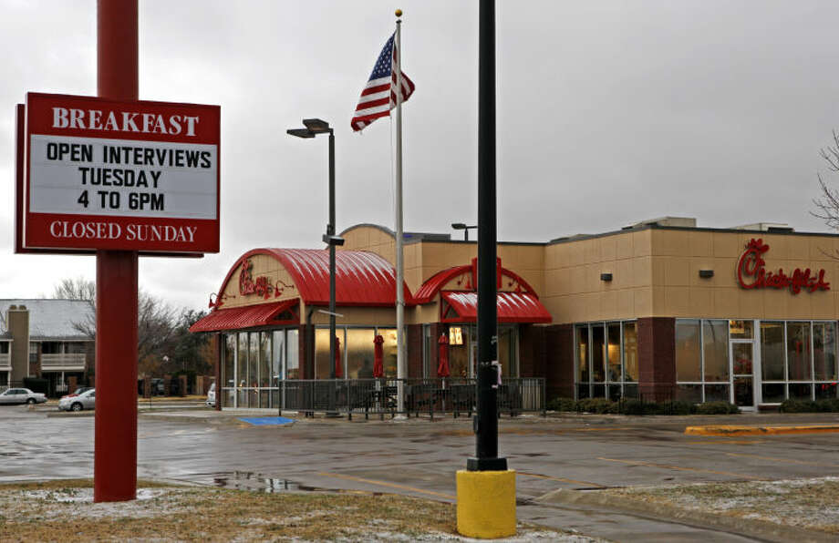 A sign outside the north side Chick-fil-A states the business is conducting interviews for new applicants, photographed Thursday. James Durbin/Reporter-Telegram Photo: JAMES DURBIN
